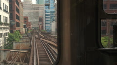 Chicago-El train-rail tracks rear view, pan reveal Stock Footage