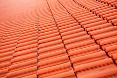 Overlapping red tiles roof rows Stock Photos