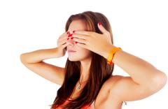 Stock Photo of Woman covering eyes