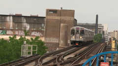 Chicago-El train drives to lens  Stock Footage