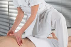 position of hands and fingers at lymphatic drainage massage - stock photo