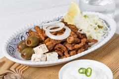 Gyros with tzatziki coleslaw olives and feta cheese Stock Photos