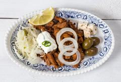 gyros with tzatziki coleslaw olives and feta cheese - stock photo
