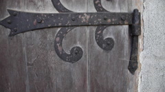 Ornamental iron hinge, old century wooden door, medieval church, castle Stock Footage