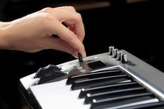Girl's hands on the keyboard of the piano Stock Photos