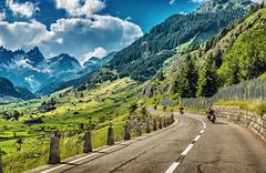 Group of bikers touring european alps Stock Photos