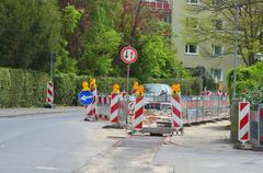 street working in residential area - stock photo