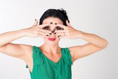 Woman covering eyes Stock Photos