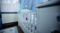 Babys room, baby nursery, babys bedroom. baby is lying in his crib - dolly shot Stock Footage