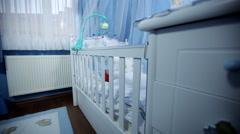 Babys room, baby nursery, babys bedroom. baby is lying in his crib - dolly shot Stock Footage