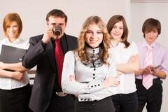 Attractive business lady and her team - stock photo