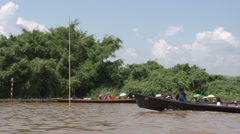 Nyaung Shwe, lots of long boats on Inle lake Stock Footage
