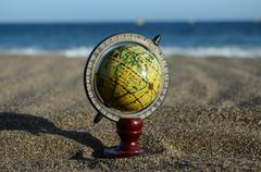 globe earth on the beach - stock photo