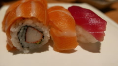 Sushi inside out roll with salmon and sake nigiri - stock footage
