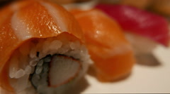 Sushi variation inside out roll and sake nigiri and tuna nigiri - Japanese food - stock footage