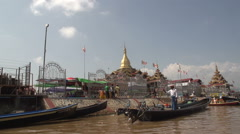 Inle lake, Cruising waterway along a temple complex Stock Footage