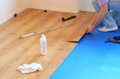 Laying laminate flooring - stock photo