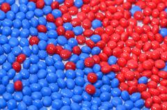 Blue and red polymer resin - stock photo