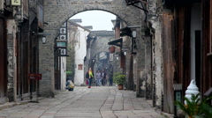 Archway, old architecture and ancient stone road in Wuzhen Stock Footage