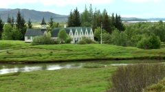 Iceland island tour 020 Icelandic landscape with church and houses Stock Footage