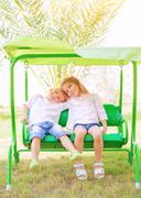 Happy kids on the swing Stock Photos