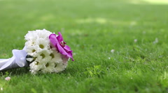 Color wedding bouquet at grass (tracking) Stock Footage