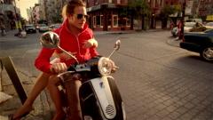 Couple riding Vespa Stock Footage