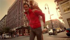 Man lifting woman on the street Arkistovideo