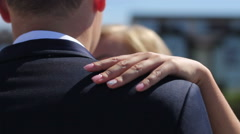 tender motion of bride's hand on groom shoulder - stock footage