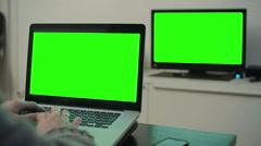 Computer TV green screen man typing keyboard  Stock Footage