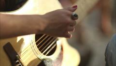 Closeup Of Young Woman's Hand, Strumming The Guitar, At Campsite (Slow Motion) Stock Footage