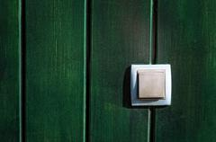 push button on wooden wall - stock photo