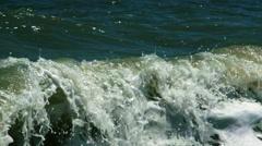Waves breaking on a seashore Stock Footage