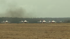 Group of jet-fighters take off airstrip - stock footage