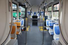 Blue and grey seats for passengers in saloon of empty city bus Kuvituskuvat