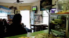 People Watching a Football Match in a Bar Stock Footage