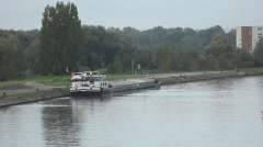 Cargo boat ready to sail on a river Stock Footage