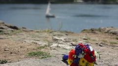 Color wedding bouquet at background of river with boat (changes focus) Stock Footage