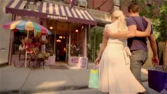 Man and woman with arms around each other shopping Stock Footage