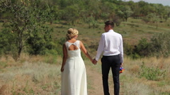 Couple walking holding hands together - stock footage