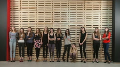 Group of young beautiful girls waiting for the wall Stock Footage