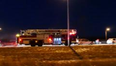4K UHD - Multiple firetrucks with lights and sirens arriving on highway Stock Footage