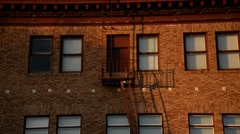 Fire Escape on a red bricked building in California Stock Footage