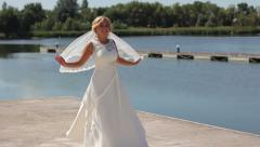 Bride spins on the background of the river Stock Footage