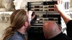 Sound Technicians Set Up Microphone Recievers Stock Footage