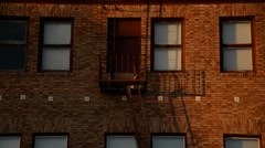 Fire Escape on a red bricked building in California - stock footage