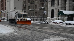 Truck snowplowing snow off street in NYC Stock Footage