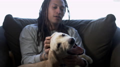 Young African American Man with Dreadlocks Playing with his Puppy Stock Footage