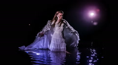 Apocalyptic angel woman dancing in water Stock Footage