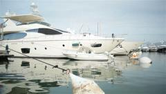 Luxury boats moored in yacht anchorage Stock Footage